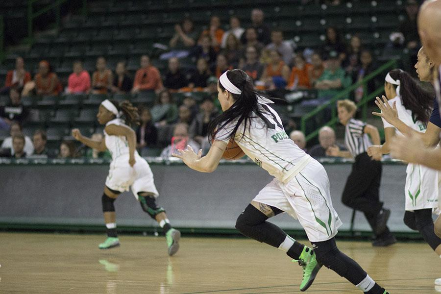 Marshall University sophomore guard Taylor Porter brings the ball up-court during a game against Rice University Jan. 16 at the Cam Henderson Center.