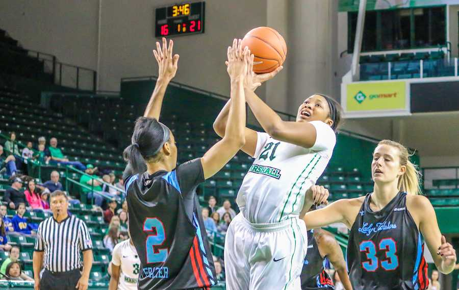 Junior forward Chelsey Romero goes up for a shot in a game last season.