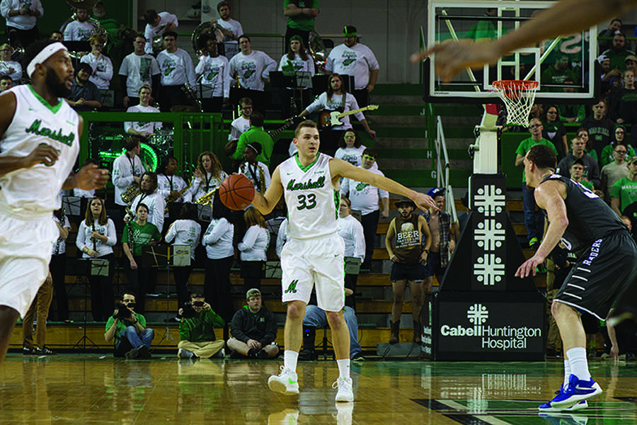 Marshall University sophomore guard Jon Elmore brings the ball up the court during a game earlier this season at the Cam Henderson Center.