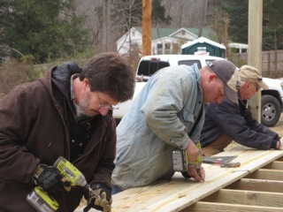 Habitat for Humanity associates work on constructing affordable housing for low income families on Monday.