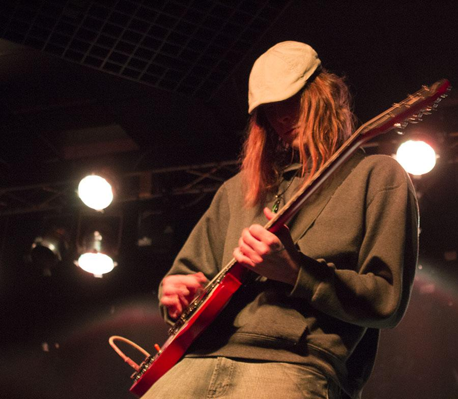 Isaac Hodges performs on guitar with local band Of The Dell, January 29 at the V-Club.