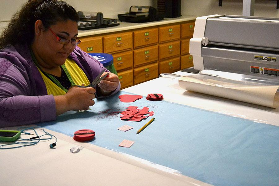 Katlyn Fitzpatrick, a grad student studying multicategorical special education, is seen utilizing the crafting station at the LRC, February 2, 2016.