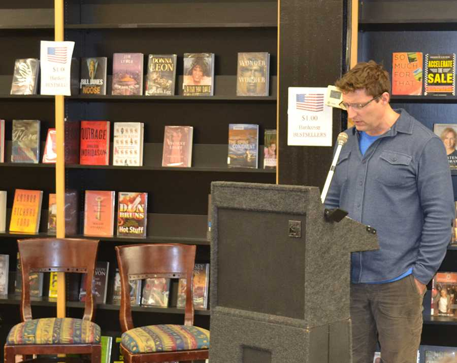 Joel Peckham reads a piece from his forthcoming book, Body Memories, during Writers Can Read Night at Empire Books and News.