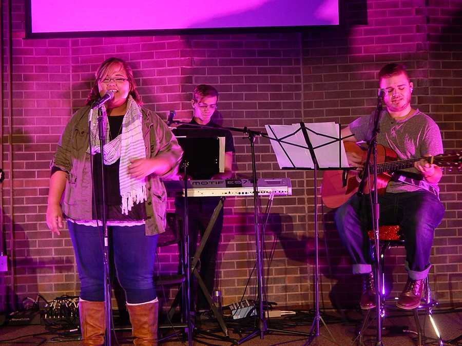 InsideOut worship team members (from left) Brandi Boltz, Justin Hesson and Mason Rimmer open up the Love Week service Monday night at the Campus Christian Center.