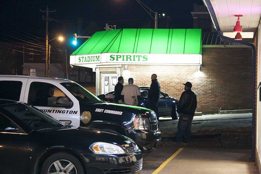 Responding officers investigate the reported gunshots fired around 7:30 p.m. outside of Stadium Spirits Tuesday, Feb. 23, 2016.
