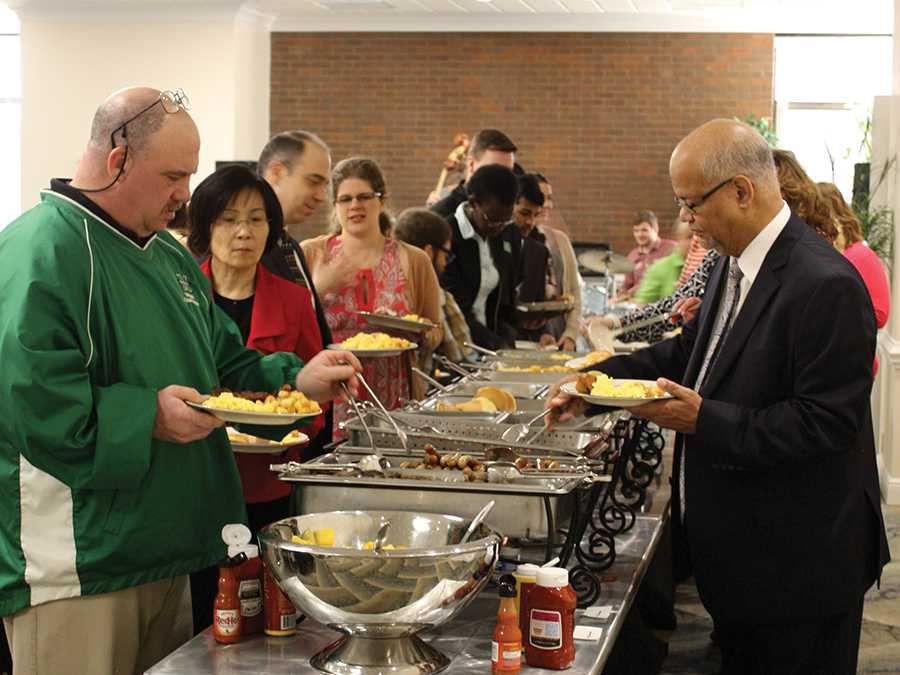Faculty and staff make their way down the buffet during the Diversity Breakfast at 7:30 a.m. Monday in the Don Morris Room of the Memorial Student Center.