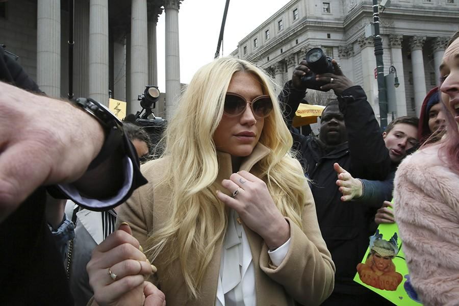 Pop+star+Kesha+leaves+Supreme+court+in+New+York%2C+Friday%2C+Feb.+19%2C+2016.+Kesha+is+fighting+to+wrest+her+career+away+from+a+hitmaker+she+says+drugged%2C+sexually+abused+and+psychologically+tormented+her+_+and+still+has+exclusive+rights+to+make+records+with+her.+Producer+Dr.+Luke+says+the+singer+is+slinging+falsehoods+and+ruining+his+reputation+to+try+to+weasel+out+of+her+recording+contract+and+strike+a+new+deal.++