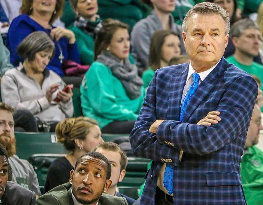 Men's basketball head coach Dan D'Antoni looks on in a game last season.