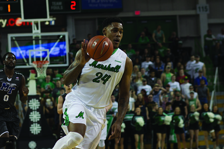 Senior forward James Kelly drives to the basket against Middle Tennessee State University Jan. 28.