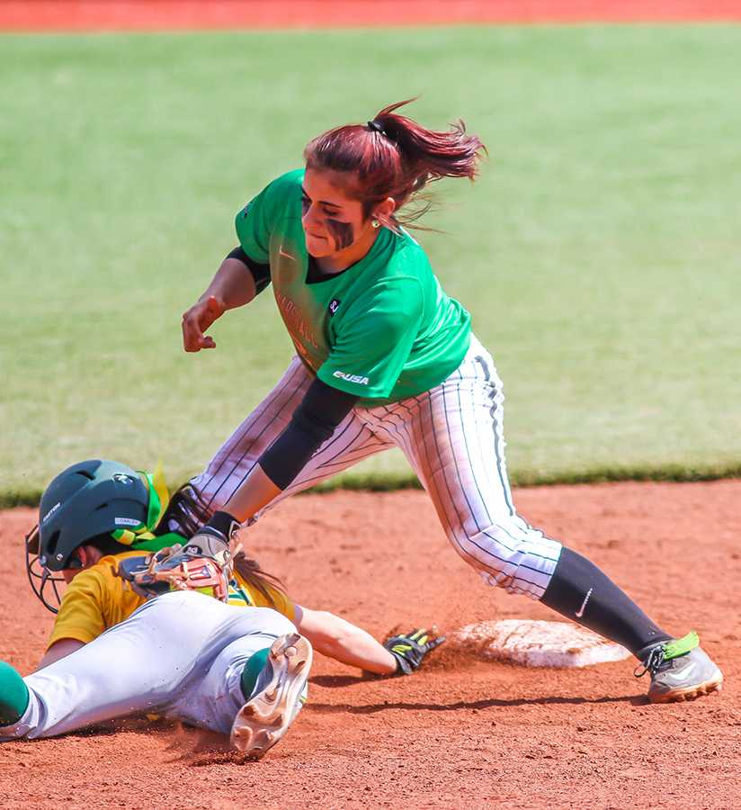 Marshall University sophomore Elicia D'Orazio tags a player out during a game last season at Dot Hicks Field.