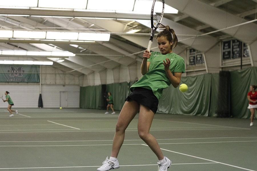 Marshall University junior Derya Turhan takes a swing last season during a match at the Huntington Tennis Club.