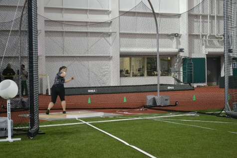 Marshall University junior Mercedes Dowell goes to throw a discus during a match earlier this season at the Chris Cline Athletic Complex.