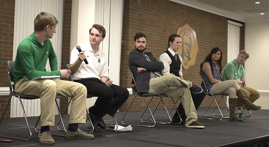 Student Body President and Vice President candidates debate Tuesday evening in the Don Morris room.