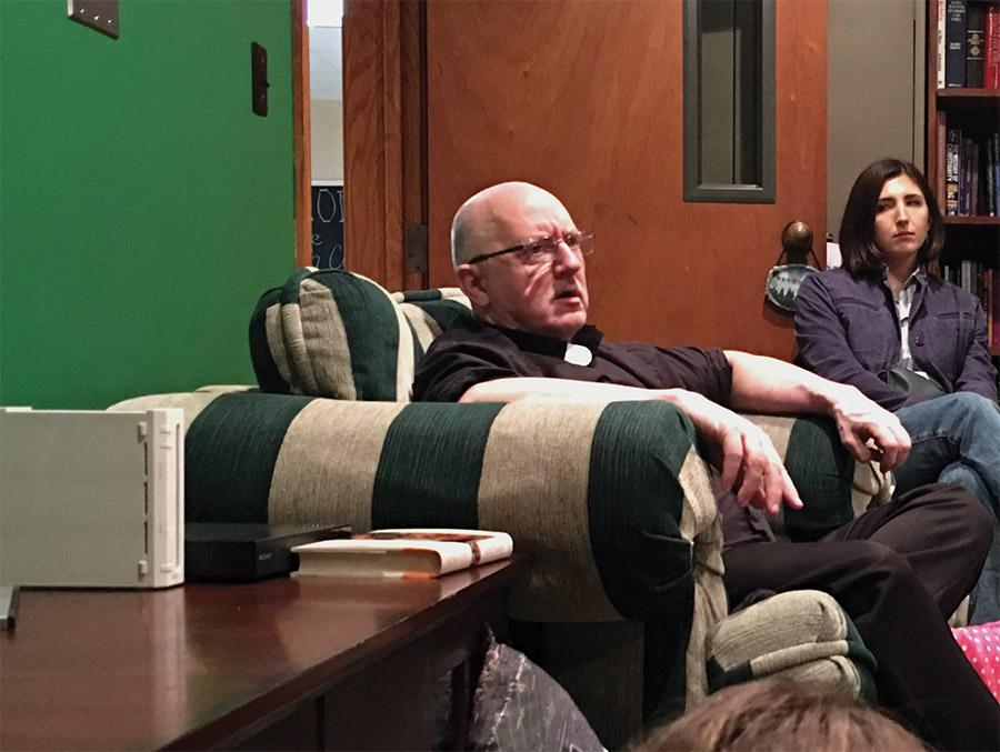 The campus parish Father Dean addresses students' questions Thursday at the Catholic Newman Center.