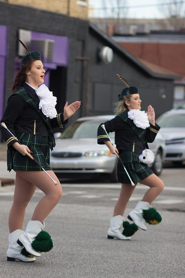 (From Left) Jakita Rowe and Mahkaylah Wheeler march as majorettes with the Huntington High School Highlanders at the St. Patrick's Day Parade on 4th Ave., March 17, 2016.