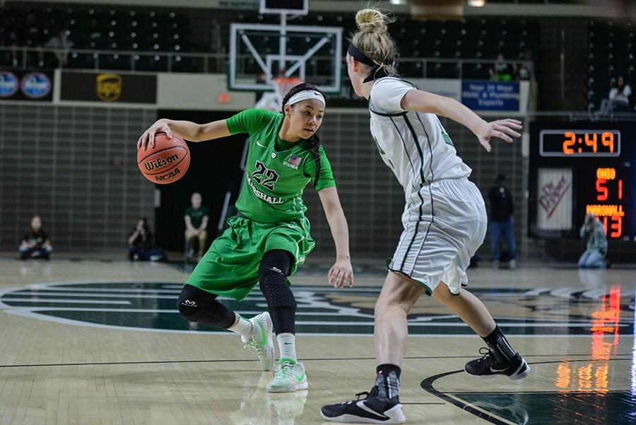 File Photo Marshall's Kiana Evans surveys the defense as the Herd take on the Ohio Bobcats in a WNIT game last season in Athens, Ohio. Evans set a new career-high in points Tuesday night with 19.