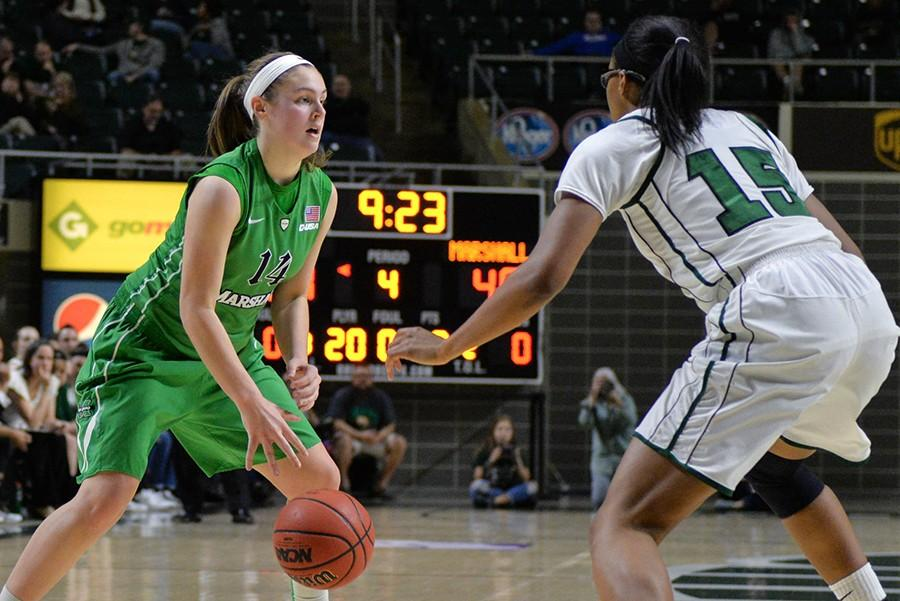 Marshall's Shayna Gore dribbles as the Herd take on the Ohio University Bobcats in the postseason WNIT game in Athens, Ohio.