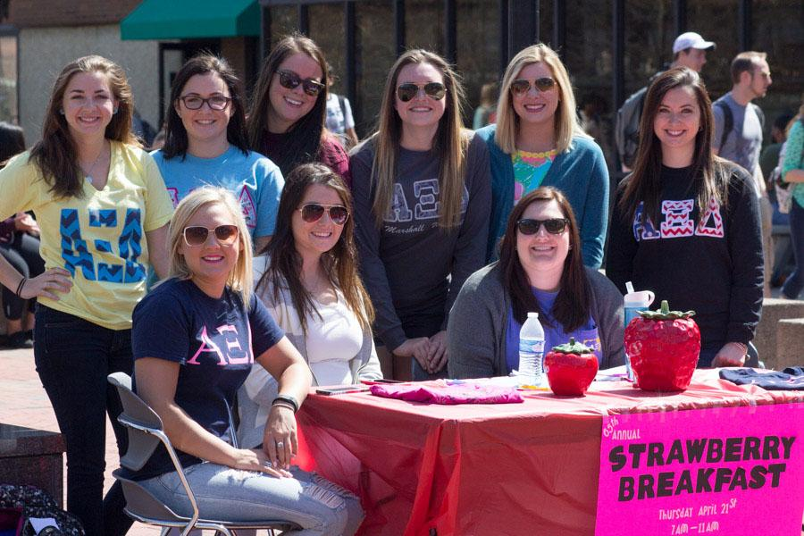 Members of Alpha Xi Delta sell tickets at the Memorial Student Center to benefit the sorority's Mother Club.