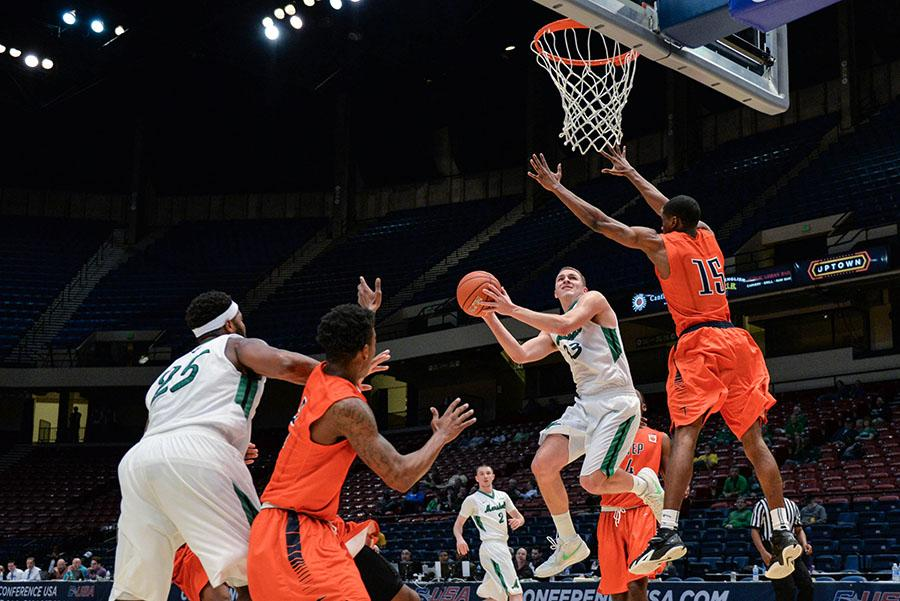 Lexi+Browning%2FThe+Parthenon%0AMarshall%27s+Jon+Elmore+shoots+for+a+two-point+shot+as+the+Herd+takes+on+UTEP+during+the+C-USA+men%E2%80%99s+basketball+quarter+finals+on+Thursday%2C+March+10+in+Birmingham%2C+AL.