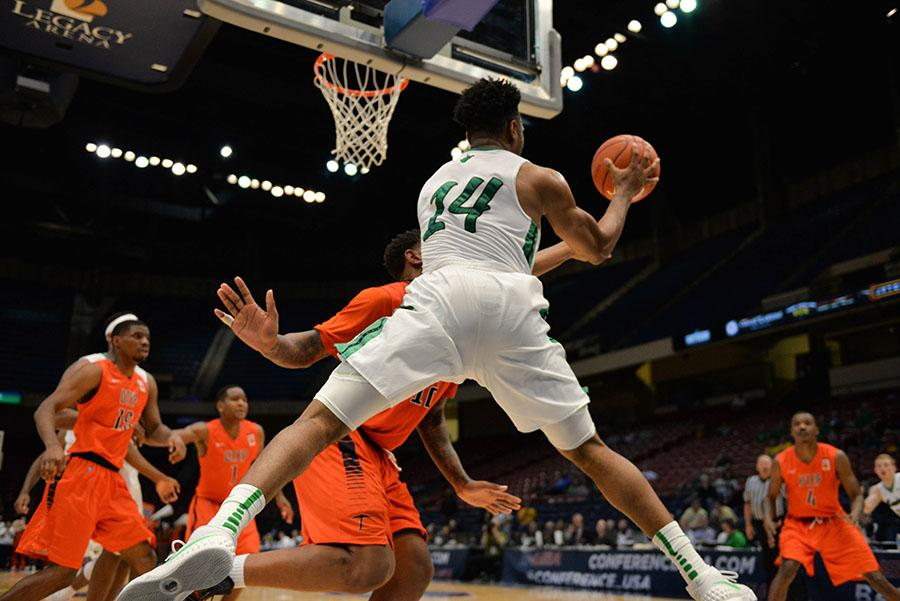 Marshall's CJ Burks (14) leaps for a pass as the Herd take on UTEP during the Conference USA men's basketball quarterfinals on Thursday, March 10 in Birmingham, AL.