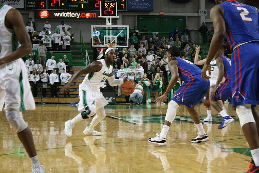 Marshall University gaurd Justin Edmonds attempts drive by a defender Thursday against Louisiana Tech University at the Cam Henderson Center.