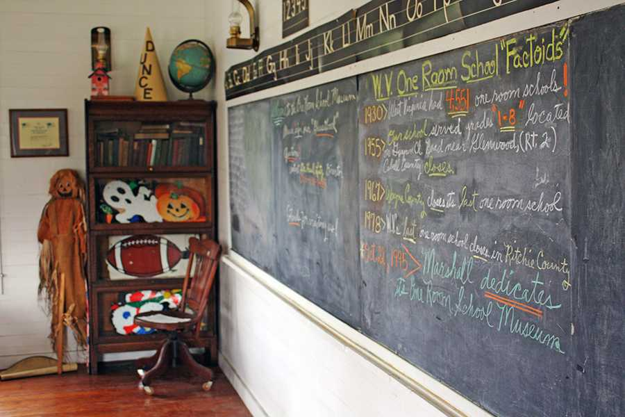 One room school house facts are displayed on a chalkboard in the Marshall University One-Room Schoolhouse Museum.