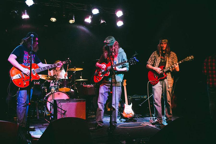 Members of Of The Dell Cody Hatton, CJ Davis, Corey Hatton and Issac Hodges perform at the V-Club Oct. 2.