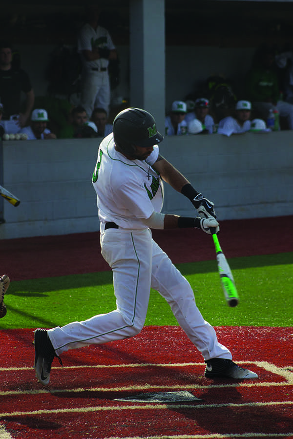 Marshall second baseman DJ Gee swings at a pitch in a game earlier this season. Gee recorded the go-ahead RBI in both Herd victories over the weekend.