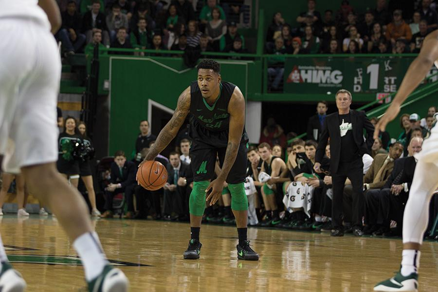 Marshall University senior James Kelly handles the ball during a game against the University of North Carolina at Charlotte Feb. 18 at the Cam Henderson Center.