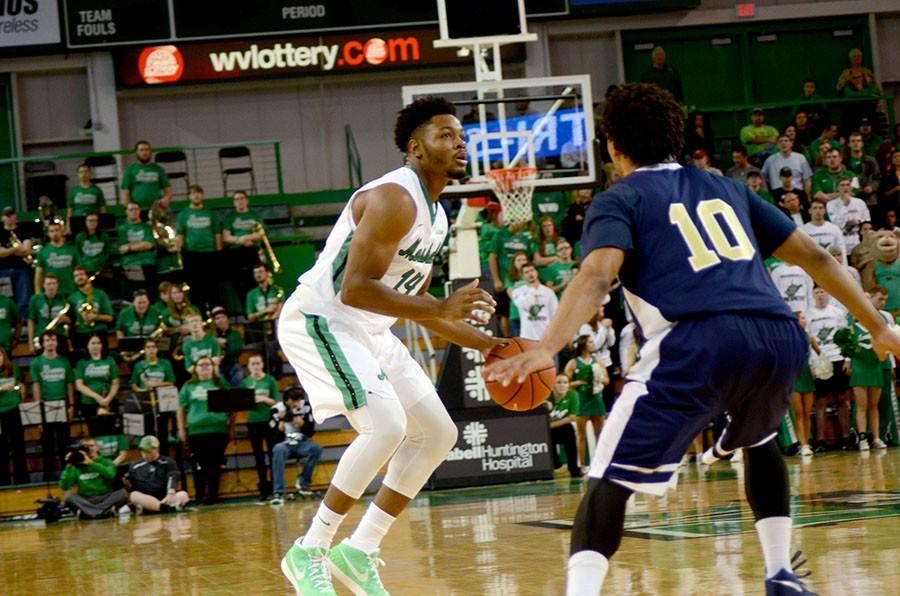 Marshall+University+redshirt+freshman+C.J.+Burks+pulls+up+for+a+3-point+shot+against+Florida+International+University+earlier+this+season+at+the+Cam+Henderson+Center.