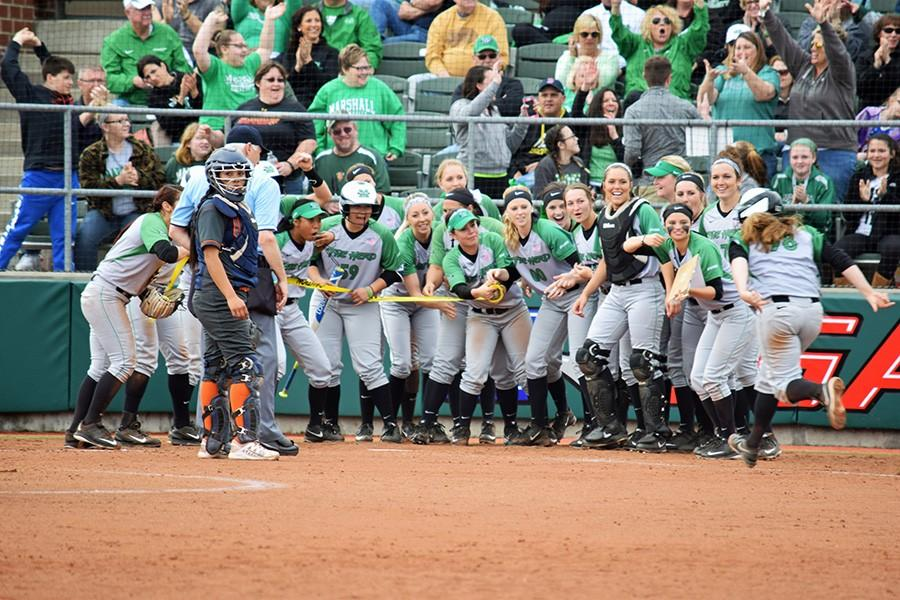 Marshall+University%E2%80%99s+softball+team+celebrates+after+a+win+against+the+University+of+Texas+at+El+Paso+Saturday+at+Dot+Hicks+Field.