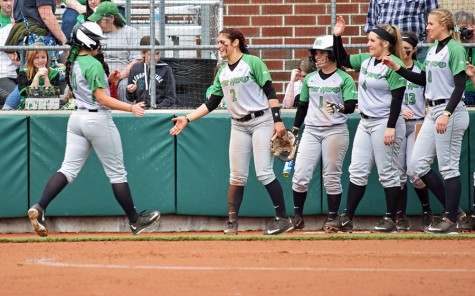 Marshall softball players give out high-fives after a run scores in a game against UTEP last weekend.