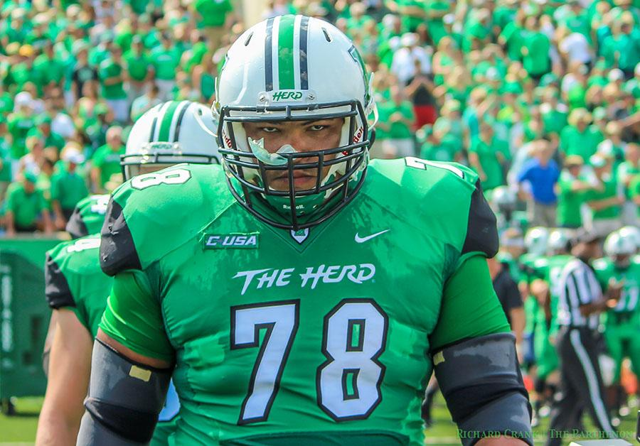 Marshall University senior offensive lineman Clint Van Horn takes the field during a game last season at Joan C. Edwards Stadium.