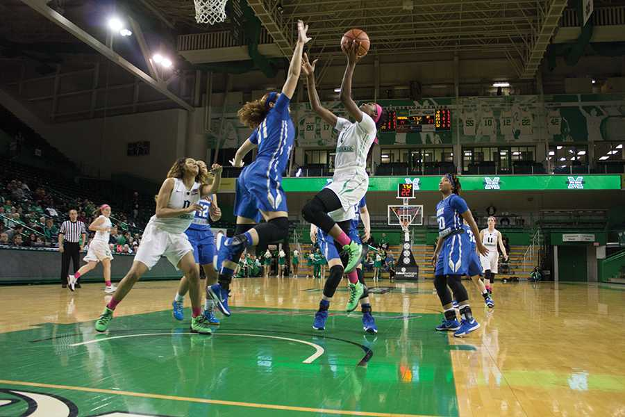 Marshall University senior Leah Scott goes for a lay-up Feb. 27 against Middle Tennesse State University.