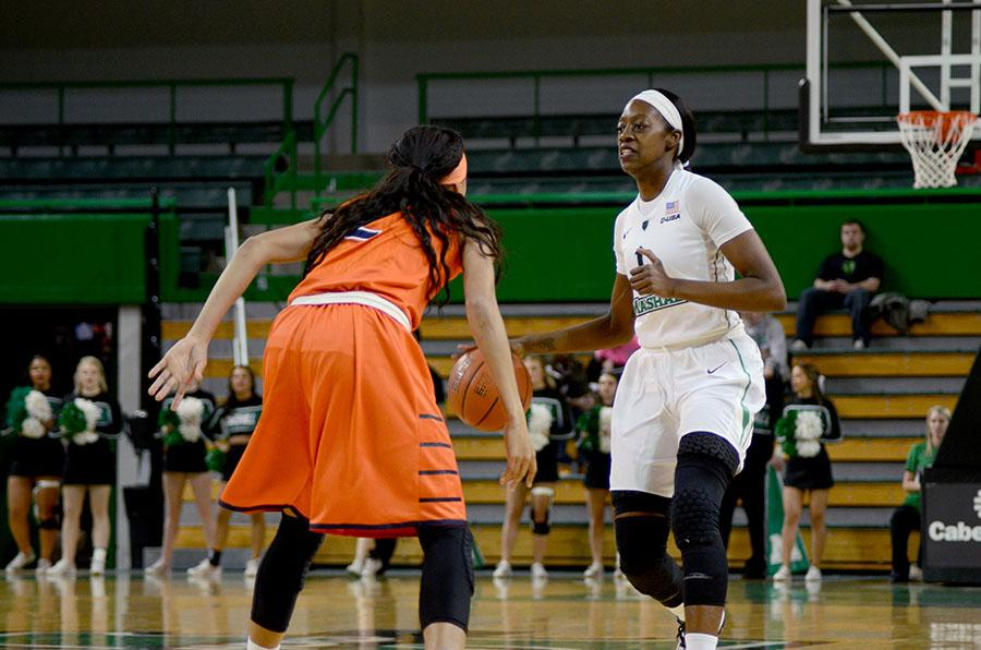 Marshall University senior guard Leah Scott brings the ball up the court Feb. 2 at the Cam Henderson Center against the University of Texas at El Paso.