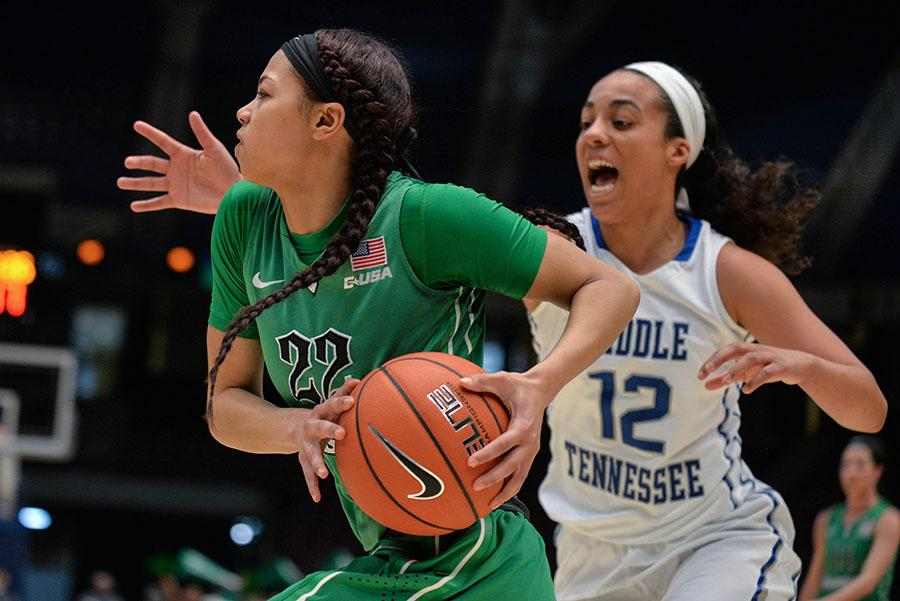 Marshall's Kiana Evans rushes toward the hoop for a two-point shot as the Herd takes on Middle Tennessee for the C-USA Women's Basketball Semi Finals on Friday in Birmingham, AL.