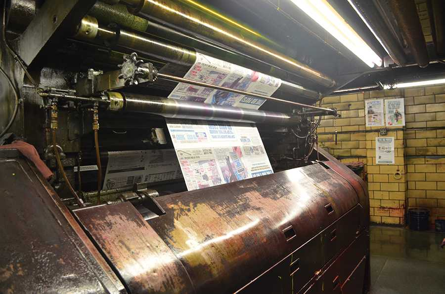 The Herald Dispatch's built-in printing press churning out one of its final editions, April 1, 2016.