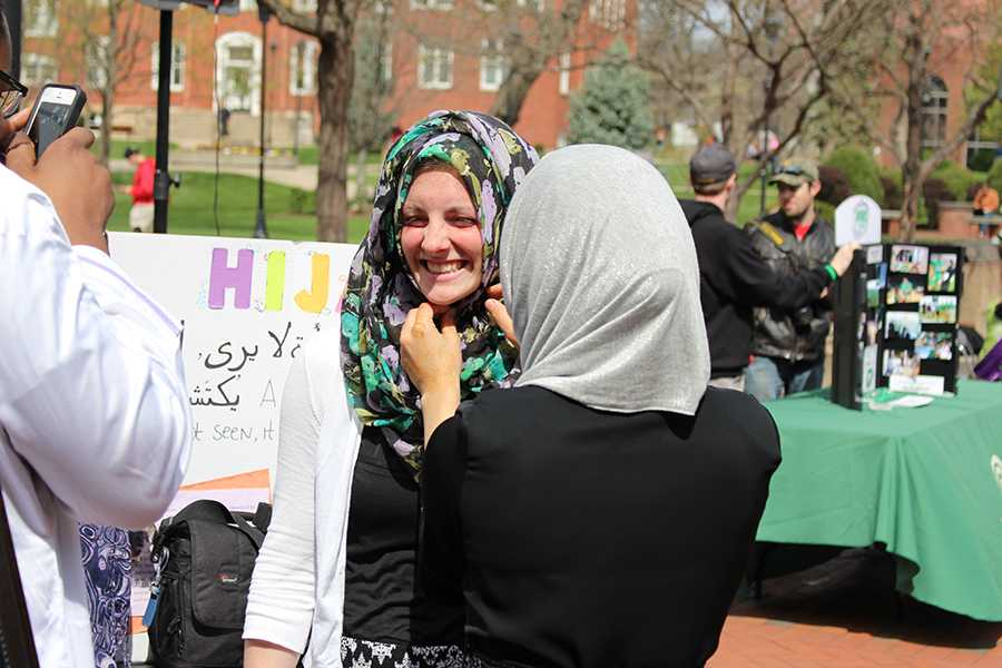 Student Katelyn McGuffin tries on a hijab at the Muslim Student Association's table outside the Memorial Student Center, April 6, 2016.