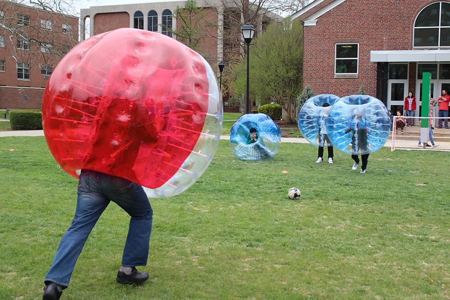 INTO+Marshall+students+compete+in+a+game+of+bubble+soccer.+