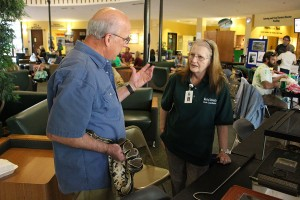 (From Left) Larry Cartmill speaks with desk coordinator Mary Tobey alongside his snake inside the Memorial Student Center during Earth Day, April 20, 2016.