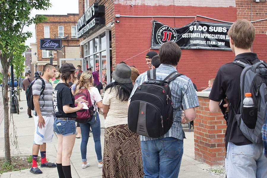 Customers await one dollar subs outside Jimmy John's on 4th Ave. during their customer appreciation day, April 21, 2016.