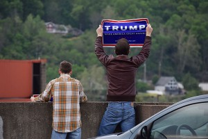 (From Right) Trevor Napper and Dustin Perry protest the Bernie Sanders rally holding signs advocating for Donald Trump, April 26, 2016.