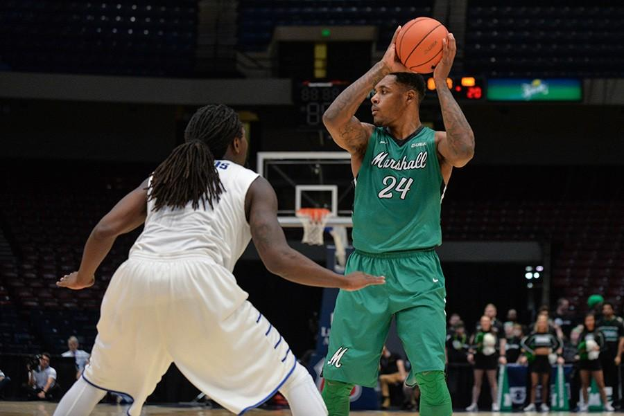 Marshall+University+senior+James+Kelly+looks+to+make+a+move+against+a+Middle+Tennessee+State+University+defender+March+11+in+the+Conference+USA+Semifinals.