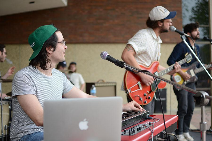 Brad Goodall, Bradley Jenkins and Zack Owens of Ona perform on the Memorial Student Center plaza Thursday afternoon.