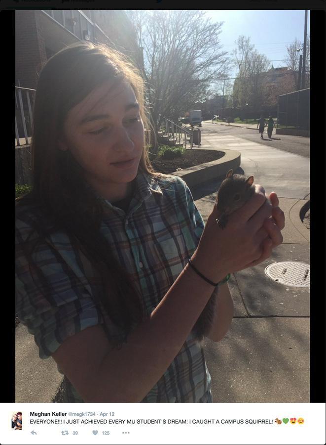 Marshall University freshman, Megan Keller holding Petunia the squirrel.