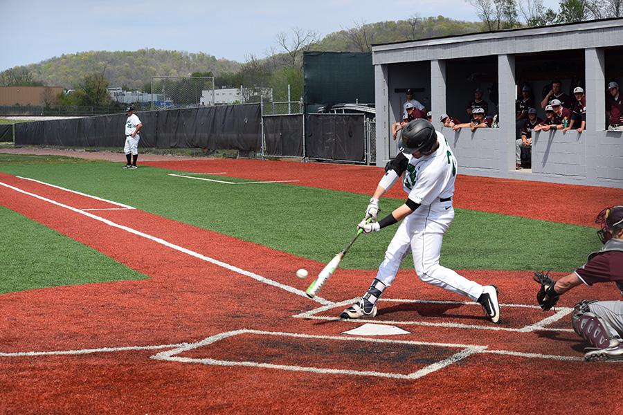 Marshall catcher Sam Finfer makes contact with a pitch in a game earlier this season.