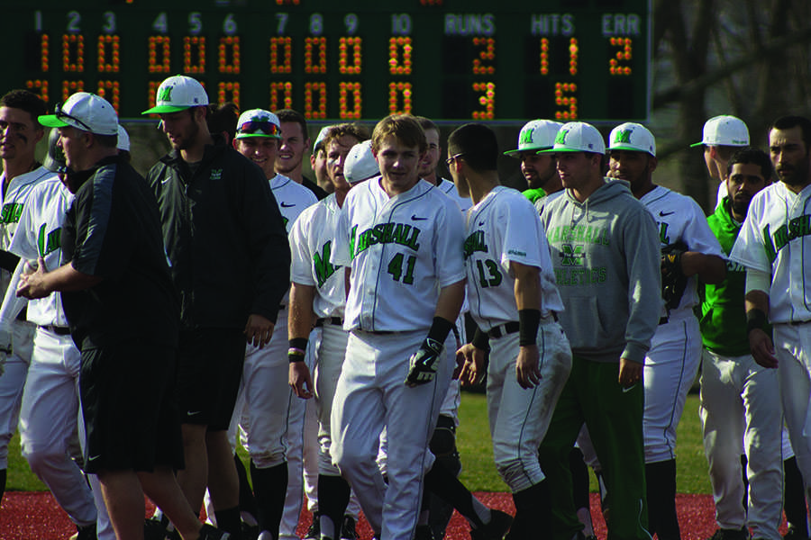 The Marshall University baseball walks off the field after a game earlier this season.