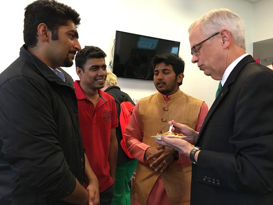 Marshall University President Gilbert enjoys an Indian cuisine while visiting the INTO: Marshall facility on Thursday for India Day.