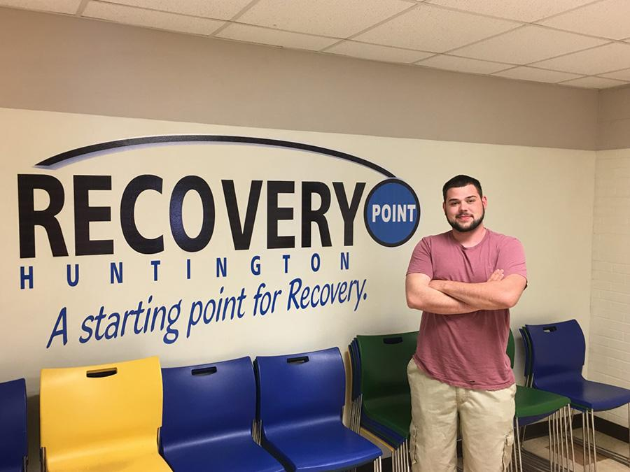Recovery Point mentor Matthew Blake, 22, assists those struggling with addictions at the rehabilitative facility in Huntington.
