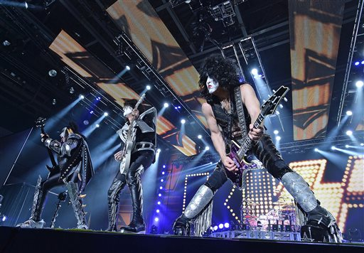 "Pictured from left to right are Kiss members Gene Simmons, Tommy Thayer and Paul Stanley as they play ""Deuce"" during their Freedom To Rock tour concert on Saturday, Aug. 27, 2016, at Erie Insurance Arena in Erie, Pa. (Christopher Millette, Erie Times-News via AP)"